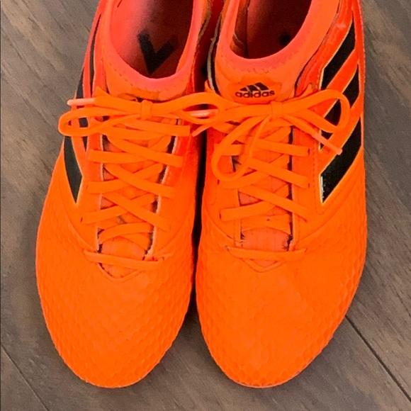 orange and black adidas cleats